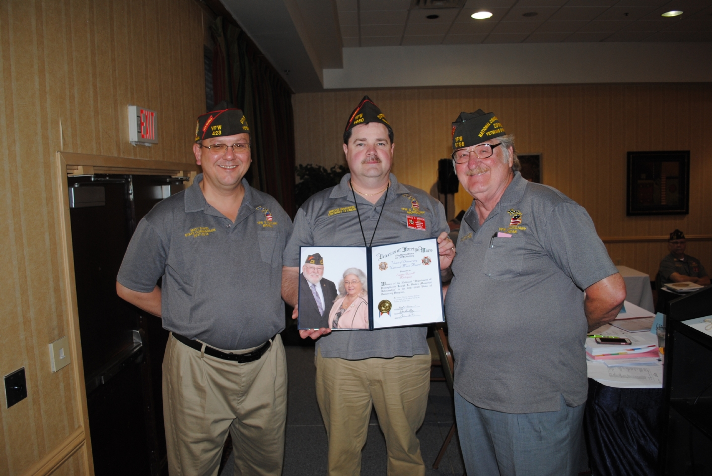 "VFW Voice of Democracy National Merit Award presented to Emma Russell accepted by Bruce Birdson (c.) presented by Matt David (l.) and Harry ""Les"" Croyle (r.)"
